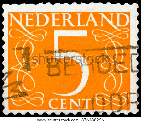 DZERZHINSK, RUSSIA - JANUARY 18, 2016: A postage stamp of NETHERLANDS shows numeric value 5 cent, circa 1955 - stock photo