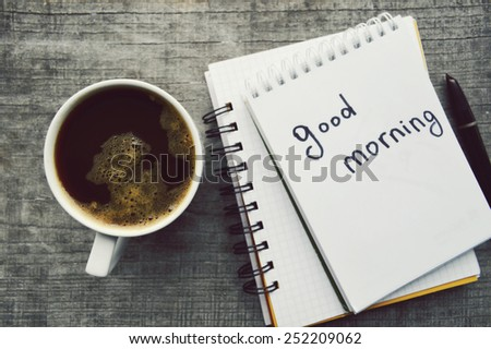 e-book.Notepad,reading glasses,hot Cup of coffee on wooden background. - stock photo
