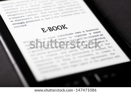E-book on tablet pc touchpad, ebook concept - stock photo