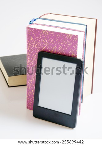 e-book reader with books - stock photo
