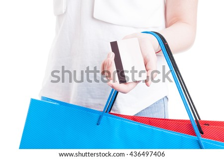E-commerce and electronic payment concept with close-up of credit card in young shopaholic hand isolated on white studio background - stock photo
