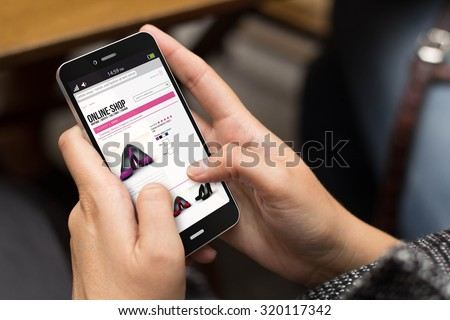 e-commerce concept: girl using a digital generated phone with eshop app on the screen. All screen graphics are made up. - stock photo