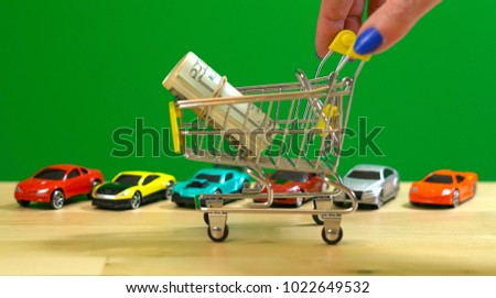 E-commerce retail shopping for cars concept with miniature shopping cart