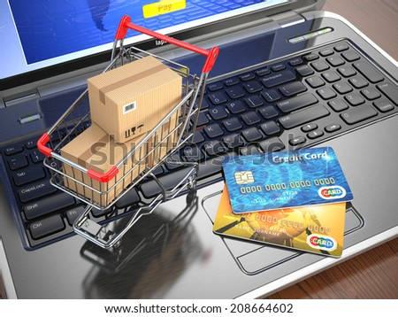 E-commerce. Shopping cart and credit cards on laptop. 3d - stock photo