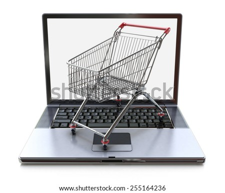 E-commerce. Shopping cart on laptop. Conceptual image