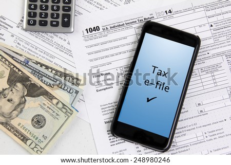 e-file taxes with mobile phone - stock photo