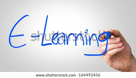 E-Learning hand writing with a blue mark on a transparent board - stock photo