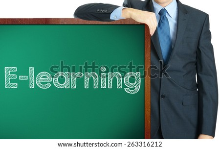 E-Learning on blackboard presenting by businessman - stock photo