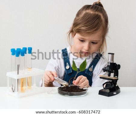 E-learning. Stem education. Little girl is in the chemistry class.