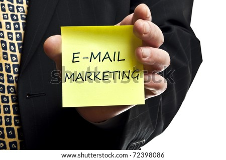 E-mail marketing post it in business man hand - stock photo