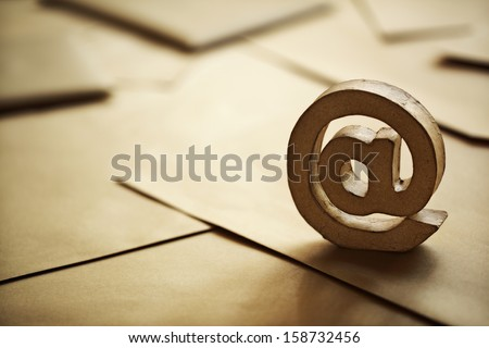 E-mail symbol on brown business letters - stock photo