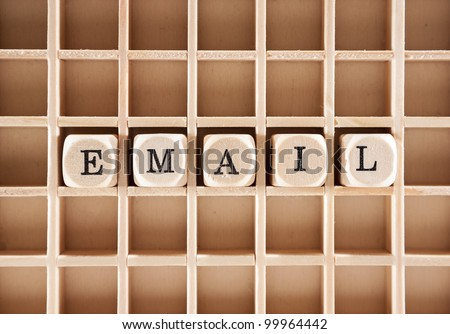 E-mail word construction with letter blocks / cubes and a shallow depth of field - stock photo