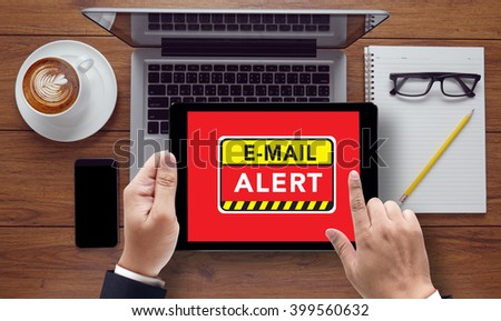 E-mails Hacked Warning Digital Browsing Concept , on the tablet pc screen held by businessman hands - online, top view - stock photo