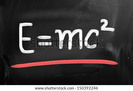 E=mc2 handwritten with chalk on a blackboard - stock photo
