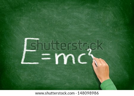 E=mc�² physics science formula equation blackboard. EMC2 written on chalkboard by science teacher or student in class. - stock photo