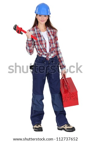 Eager young female plumber - stock photo
