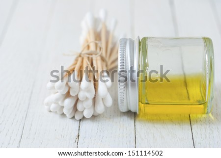 ear buds and cleaning baby oil - stock photo
