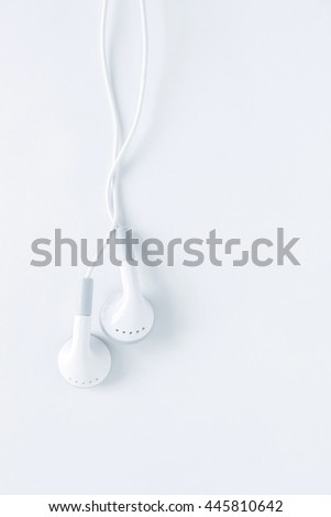 ear buds or earphones top view on white background