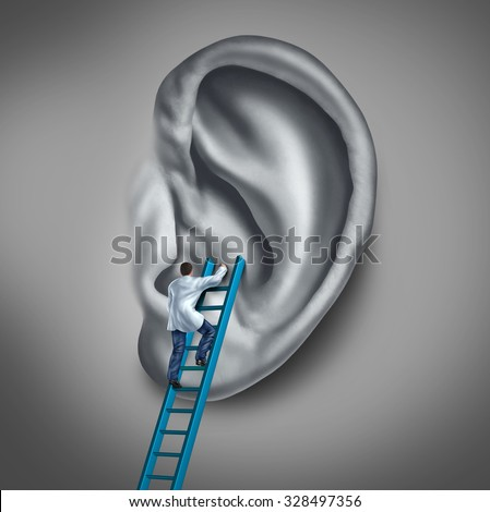 Ear medicine medical concept as a doctor or health specialist treating the human hearing organ as a physician performing an examination for auditory symptoms or earache infection. - stock photo