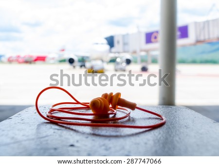 Ear plugs for work in airport - stock photo