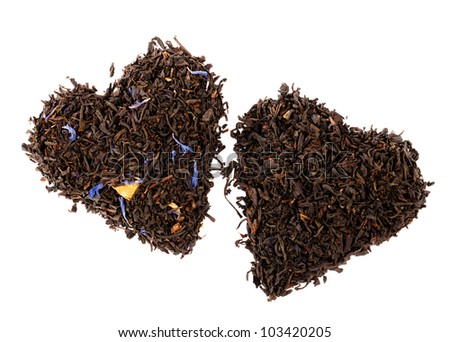 Earl Grey and Lady Grey black loose tea leaves in heart shape, isolated on white