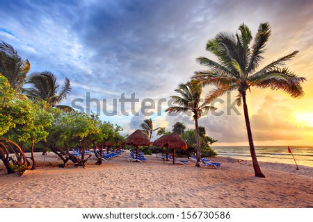Early dawn on the beach as the storm passes in HDR - stock photo