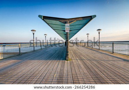 Early evening at the pier at Boscombe in Dorset - stock photo