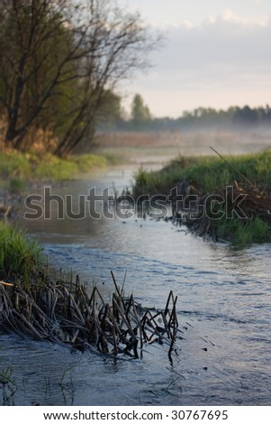 early foggy morning on the little river in the country - stock photo