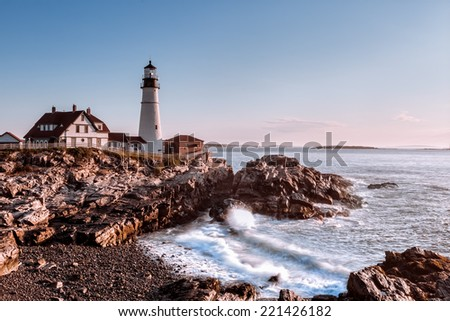 Early morning at Portland Headlight, Maine,USA. As the sun was rising up it wrapped up the lighthouse with a warm light. - stock photo
