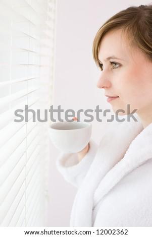 Early morning / beautiful woman drinking coffee - stock photo