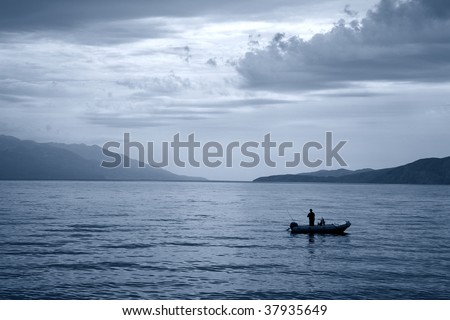 Early morning fishing - Croatia. Duotone. - stock photo