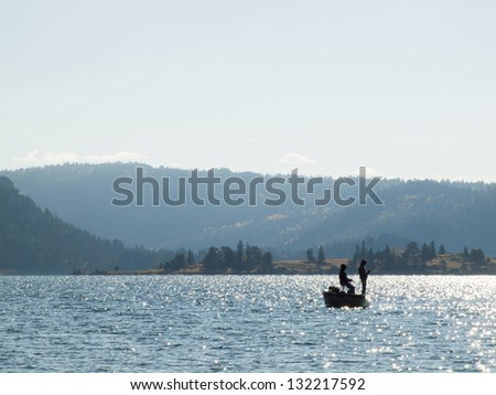 Early morning fishing from the boat in Autumn. - stock photo