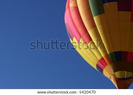 Early morning hot air balloon ascending - stock photo