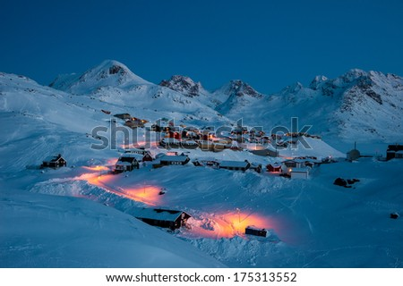 Early morning in Tasiilaq, small town situated in a fjord surrounded by high mountains, Greenland. - stock photo