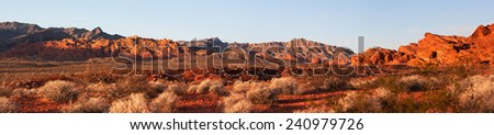 Early morning light on the Sandstone in this Panorama from Valley of Fire State Park, Nevada - stock photo
