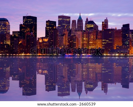 Early Morning Manhattan skyline with water reflection - stock photo