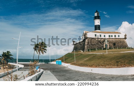 Early morning near Barra Lighthouse (Farol da Barra) in Salvador, Brazil. LIghthouse was built in 1698 and was the first lighthouse in the Americas.  - stock photo