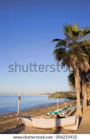Early morning on a beach by the Mediterranean Sea in Marbella, Costa del Sol, Andalucia, Spain. - stock photo