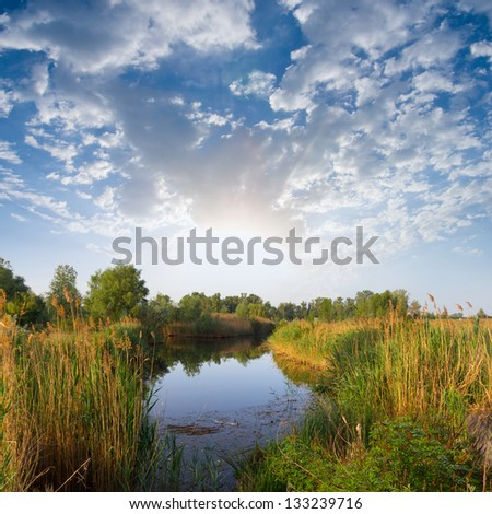 early morning on a quiet river - stock photo