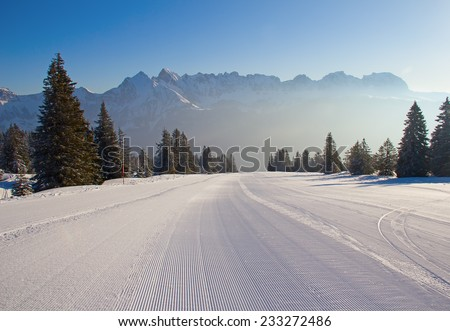 Early morning on slope on the skiing resort Flumserberg. Switzerland - stock photo