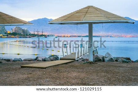 Early morning on the central beach of Eilat - famous resort city on the Red Sea, Israel
