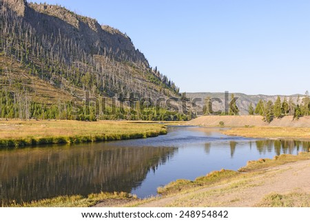 Early Morning on the Madison River in Yellowstone National Park - stock photo