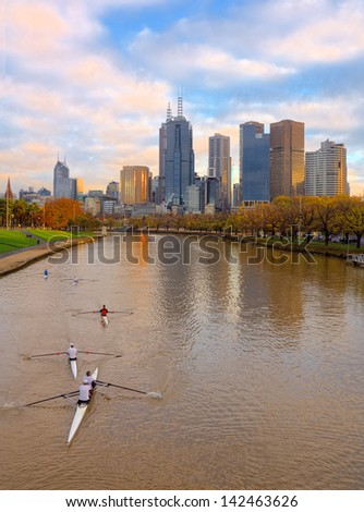 Early morning rowers on the yarra river on Melborune - stock photo