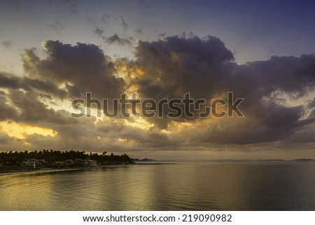 Early morning sun over a fishing village in the Philippines. - stock photo
