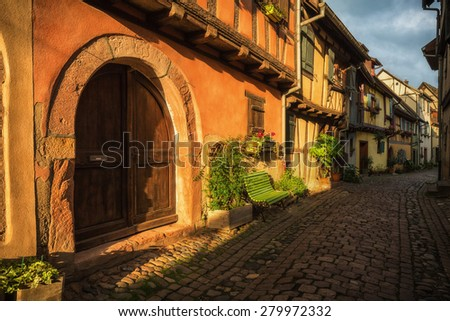 Early morning sunlight breaking on the narrow streets of a typical Alsatian village, France