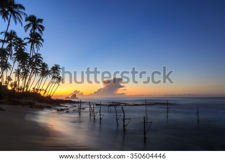 Early morning sunrise at the beach in Sri Lanka - stock photo