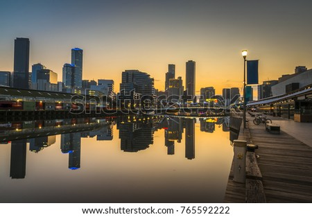 early morning sunrise docklands reflections Melbourne city skyline river bank