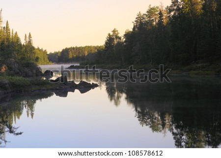 Early morning sunrise on the remote lake in Minnesota, USA - stock photo