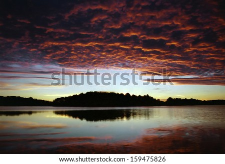 Early morning vibrant sunrise with graphic clouds
