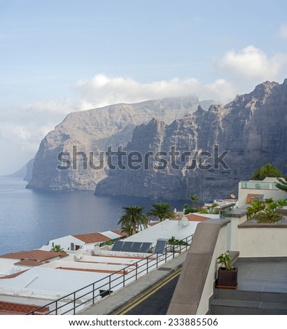 Early morning view of Gigantes cliffs, ocean and hotels roofs from top part of Los Gigantes, Tenerife Island, Canary Islands, Spain.